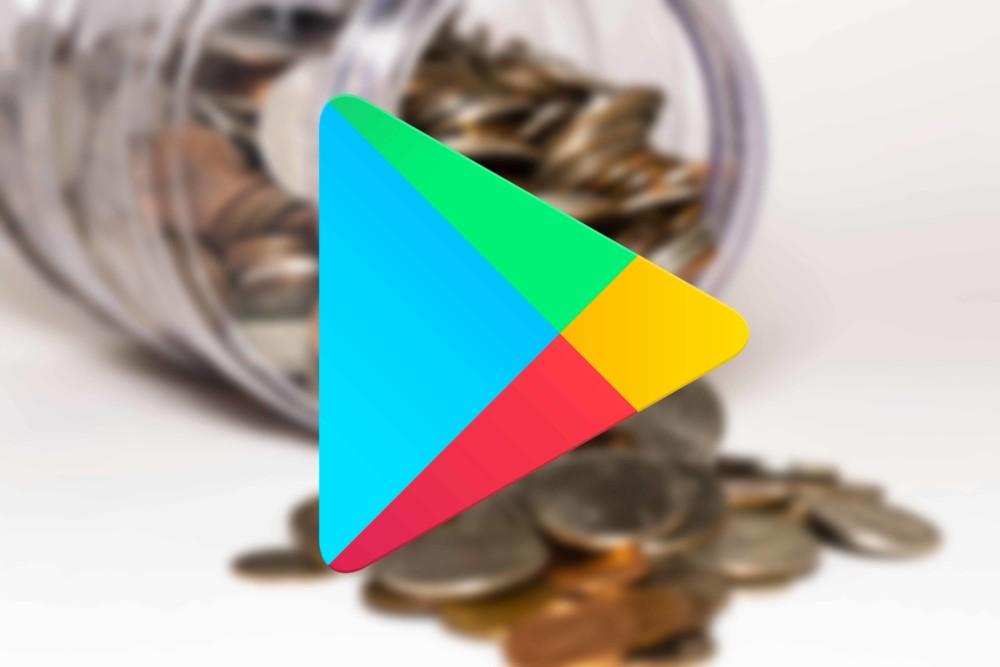 Logo du Google Play Store et pièces de monnaie