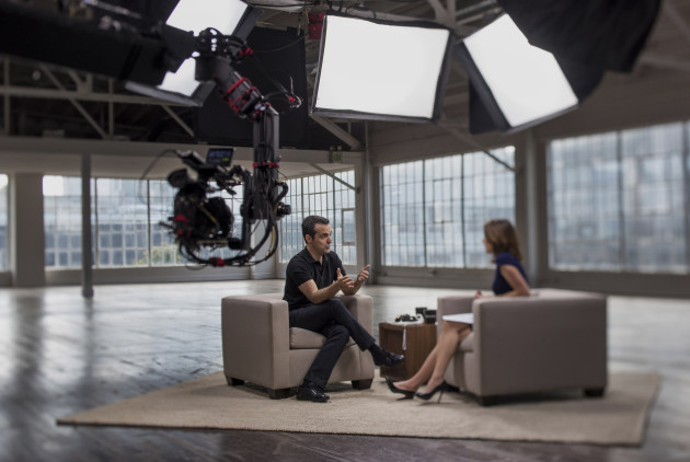 Hugo Barra, vice president of global operations at Xiaomi Corp., left, speaks in this photo taken with a tilt-shift lens during a Bloomberg Studio 1.0 interview in San Francisco, California, U.S., on Thursday, May 28, 2015. Xiaomi Corp. develops, manufactures and distributes communication equipment and parts supplying mobile phones, android devices, smartphone software, smart set-top boxes and related accessories. Photographer: David Paul Morris/Bloomberg *** Local Caption *** Hugo Barra