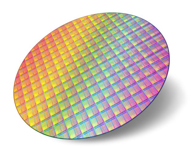 Silicon wafer with processor cores isolated on white background