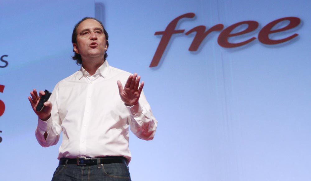 Xavier Niel, main shareholder of French broadband Internet provider Iliad, speaks during a news conference to launch the new Freebox Revolution (internet multimedia modem) in Paris December 14, 2010. The Freebox Revolution is designed by French designer Philippe Starck. REUTERS/Jacky Naegelen (FRANCE - Tags: BUSINESS SCI TECH)