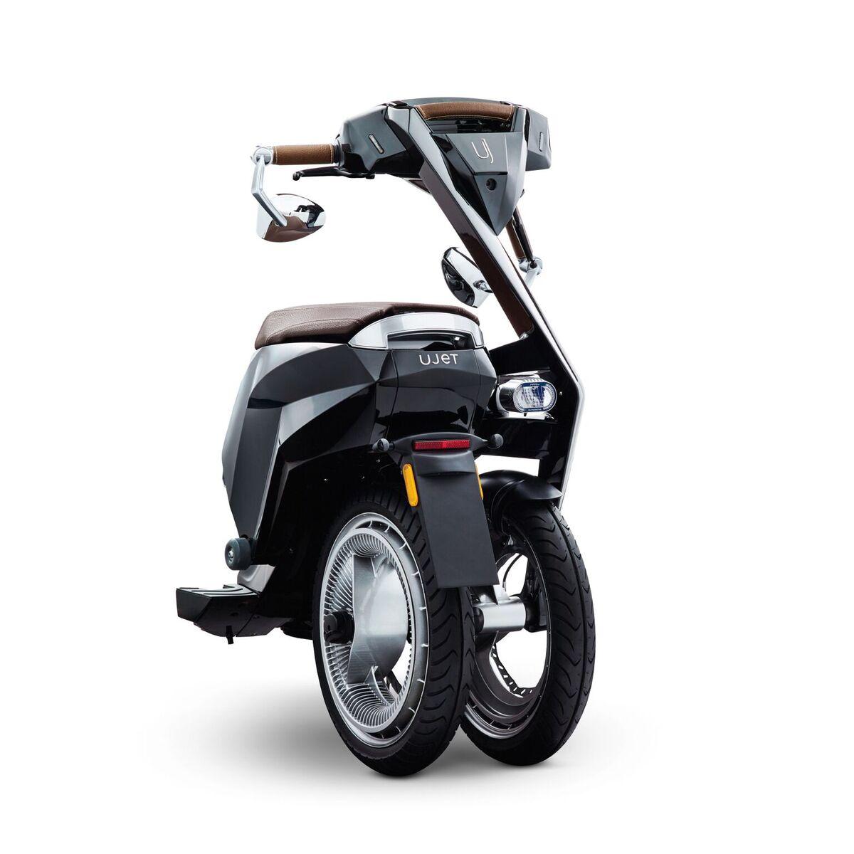 ujet ce scooter lectrique pliable et connect tient dans un coffre de voiture frandroid. Black Bedroom Furniture Sets. Home Design Ideas