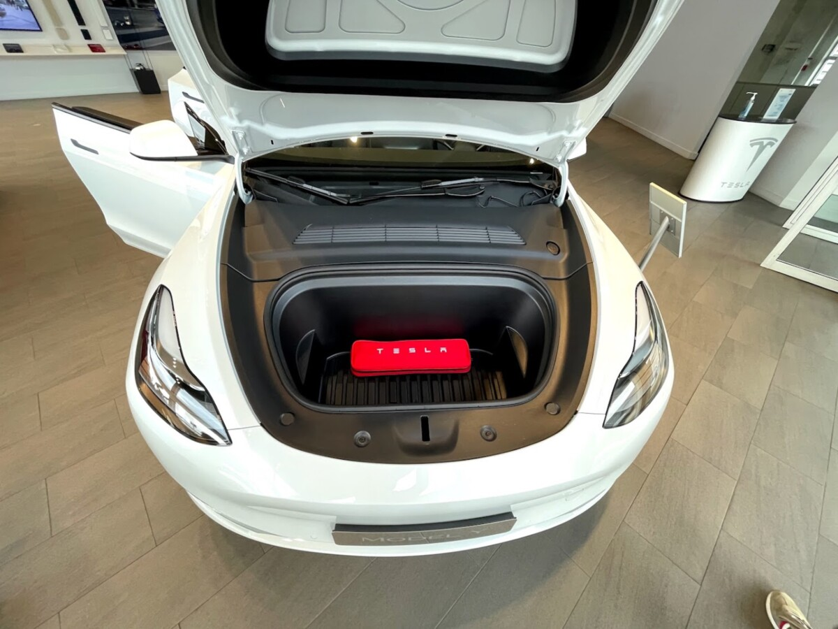 The front trunk is 117 liters, you can fit a large cabin suitcase (and even more things)